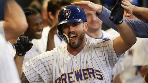 <p>               Milwaukee Brewers' Mike Moustakas is congratulated after hitting a home run during the seventh inning of a baseball game against the Pittsburgh Pirates Friday, Sept. 14, 2018, in Milwaukee. (AP Photo/Morry Gash)             </p>