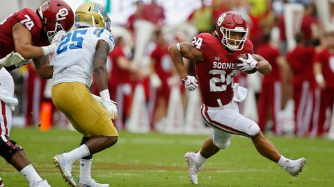 <p>               Oklahoma running back Rodney Anderson (24) runs around UCLA linebacker Tyree Thompson (25) in the first half of an NCAA college football game in Norman, Okla., Saturday, Sept. 8, 2018. (AP Photo/Sue Ogrocki)             </p>