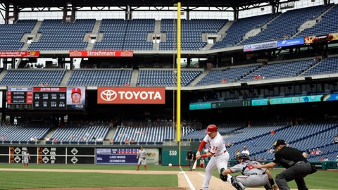 <p>               Philadelphia Phillies' Justin Bour, left, hits a double off Washington Nationals relief pitcher Erick Fedde during the first inning of the first game of a baseball doubleheader, Tuesday, Sept. 11, 2018, in Philadelphia. At center is catcher Spencer Kieboom and at right is home plate umpire Bruce Dreckman. (AP Photo/Matt Slocum)             </p>