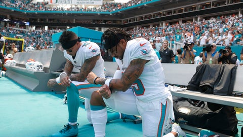 <p>               Miami Dolphins wide receiver Kenny Stills (10) and Miami Dolphins wide receiver Albert Wilson (15) kneel during the national anthem before an NFL football game against the Tennessee Titans, Sunday, Sept. 9, 2018, in Miami Gardens, Fla. (AP Photo/Wilfredo Lee)             </p>