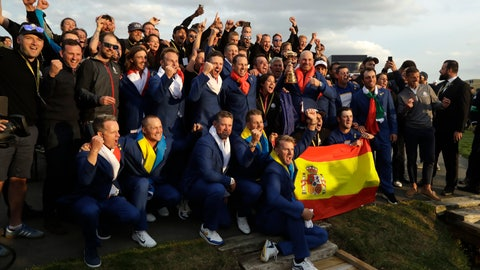<p>               Europe team captain Thomas Bjorn holds the trophy as he celebrates with his team after Europe won the Ryder Cup on the final day of the 42nd Ryder Cup at Le Golf National in Saint-Quentin-en-Yvelines, outside Paris, France, Sunday, Sept. 30, 2018. (AP Photo/Matt Dunham)             </p>