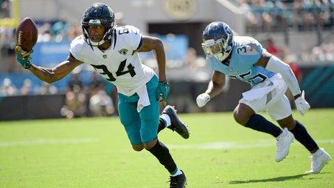 <p>               Jacksonville Jaguars wide receiver Keelan Cole (84) lets a pass slip away as he is defended by Tennessee Titans cornerback LeShaun Sims (36) during the first half of an NFL football game, Sunday, Sept. 23, 2018, in Jacksonville, Fla. (AP Photo/Phelan M. Ebenhack)             </p>