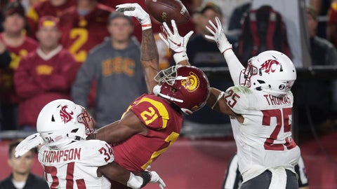 <p>               Southern California wide receiver Tyler Vaughns, center, misses a pass between Washington State safety Jalen Thompson, left, and safety Skyler Thomas during the first half of an NCAA college football game Friday, Sept. 21, 2018, in Los Angeles. (AP Photo/Jae C. Hong)             </p>
