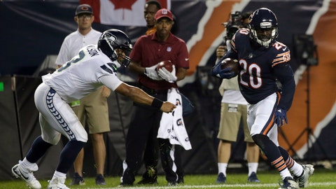 <p>               Chicago Bears defensive back Prince Amukamara (20) runs away from Seattle Seahawks quarterback Russell Wilson (3) to the end zone for a touchdown after intercepting a pass during the second half of an NFL football game Monday, Sept. 17, 2018, in Chicago. (AP Photo/David Banks)             </p>