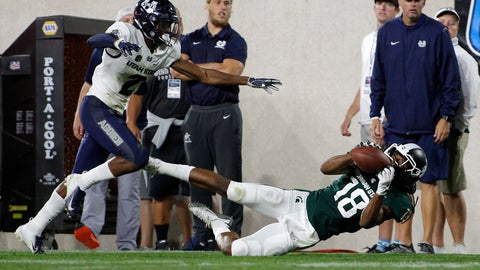 <p>               Michigan State's Felton Davis III, right, makes a catch while falling down against Utah State's Ja'Marcus Ingram during the fourth quarter of an NCAA college football game, Friday, Aug. 31, 2018, in East Lansing, Mich. (AP Photo/Al Goldis)             </p>