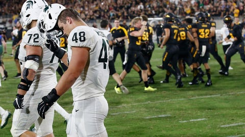 <p>               As Arizona State players celebrate a game-winning field goal, Michigan State defensive end Kenny Willekes (48) and defensive tackle Mike Panasiuk (72) walk off the field at the end of an NCAA college football game Saturday, Sept. 8, 2018, in Tempe, Ariz. Arizona State defeated Michigan State 16-13. (AP Photo/Ross D. Franklin)             </p>