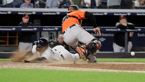 <p>               New York Yankees' Didi Gregorius slides past Baltimore Orioles catcher Caleb Joseph to score during the eleventh inning of a baseball game Saturday, Sept. 22, 2018, in New York. The Yankees won 3-2. (AP Photo/Frank Franklin II)             </p>