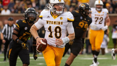 <p>               Wyoming quarterback Tyler Vander Waal, center, runs away from Missouri's Adam Sparks, left, and Walter Palmore, right, during the first half of an NCAA college football game Saturday, Sept. 8, 2018, in Columbia, Mo. (AP Photo/L.G. Patterson)             </p>