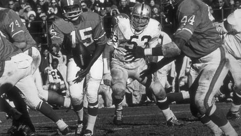 <p>               In this undated handout from the Denver Broncos, Marlin Briscoe completes the option to Floyd Little. Fifty years ago, Marlin Briscoe became the first black quarterback to play in the American Football League. He started five games for the Denver Broncos and was runner-up for AP's AFL Rookie of the Year award in 1968. The Pro Football Hall of Fame calls the Omaha, Neb. native the first black quarterback in the modern era of pro football. (Denver Broncos via AP)             </p>