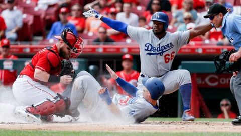 <p>               Los Angeles Dodgers' Joc Pederson (31) scores against Cincinnati Reds catcher Tucker Barnhart, left, as Yasiel Puig (66) reacts in the fifth inning of a baseball game, Wednesday, Sept. 12, 2018, in Cincinnati. (AP Photo/John Minchillo)             </p>