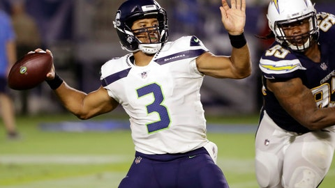 <p>               FILE - In this Aug. 18, 2018, file photo, Seattle Seahawks quarterback Russell Wilson (3) prepares to throw as Los Angeles Chargers defensive end Darius Philon, right, closes in during the first half of an NFL preseason football game in Carson, Calif. Denver Broncos' Von Miller is to face Wilson for just the second time Sunday, Sept. 9, 2018. (AP Photo/Gregory Bull, File)             </p>