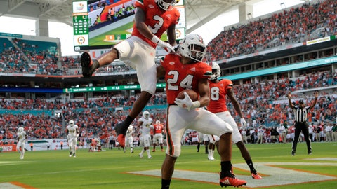 <p>               Miami wide receiver Mike Harley (3) celebrates after running back Travis Homer (24) scored a touchdown during the second half of an NCAA college football game against FIU, Saturday, Sept. 22, 2018, in Miami Gardens, Fla. (AP Photo/Lynne Sladky)             </p>