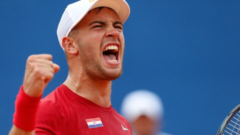 <p>               Borna Coric of Croatia celebrates after winning the second set as he plays against Steve Johnson of the United States during a Davis Cup semifinal singles tennis match between Croatia and the United States in Zadar, Croatia, Friday, Sept. 14, 2018. (AP Photo/Darko Bandic)             </p>