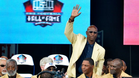 """<p>               FILE - In this Aug. 2, 2014, file photo, enshrinee Eric Dickerson is introduced during the Pro Football Hall of Fame enshrinement ceremony, in Canton, Ohio. A group of Pro Football Hall of Famers is demanding health insurance coverage and a share of NFL revenues or else those former players will boycott the induction ceremonies. In a letter sent to NFL Commissioner Roger Goodell, NFLPA Executive Director DeMaurice Smith and Hall of Fame President David Baker — and obtained by The Associated Press — 21 Hall of Fame members cited themselves as """"integral to the creation of the modern NFL, which in 2017 generated $14 billion in revenue."""" Among the signees were Eric Dickerson. (AP Photo/David Richard, File)             </p>"""