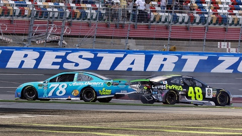 <p>               Martin Truex Jr., (78) and Jimmie Johnson (48) crash on the final lap during the NASCAR Cup series auto race at Charlotte Motor Speedway in Concord, N.C., Sunday, Sept. 30, 2018. (AP Photo/Chuck Burton)             </p>