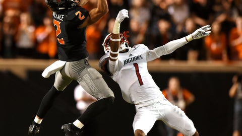 <p>               Oklahoma State wide receiver Tylan Wallace (2) catches a pass despite pressure from South Alabama corner back Jalen Thompson (1) during an NCAA college football game in Stillwater, Okla., Saturday, Sept. 8, 2018. Wallace led Oklahoma State receiving yards with 166 in the 55-13 win over South Alabama. (AP Photo/Brody Schmidt)             </p>