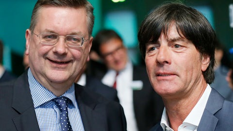 <p>               FILE - The April 15, 2016 file photo shows the President of German Soccer Federation Reinhard Grindel, left, posing with the coach of German national soccer team Joachim Loew after a meeting of the German Football Federation DFB in Frankfurt, Germany.   UEFA will decide Thursday, Sept 27, 2018 on the host country for the 2024 soccer Euro.  (AP Photo/Michael Probst, file)             </p>