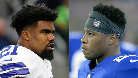 <p>               FILE - At left, in a Dec. 24, 2017, file photo, Dallas Cowboys' Ezekiel Elliott stands on the field during warmups before an NFL football game against the Seattle Seahawks, in Arlington, Texas. At right, in an Aug. 30, 2018, file photo, New York Giants running back Saquon Barkley looks on from the bench during the first half of an NFL preseason football game against the New England Patriots, in East Rutherford. (AP Photo/File)             </p>