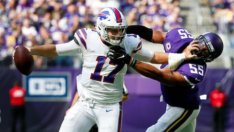 <p>               Buffalo Bills quarterback Josh Allen tries to break a tackle by Minnesota Vikings linebacker Anthony Barr (55) during the first half of an NFL football game, Sunday, Sept. 23, 2018, in Minneapolis. (AP Photo/Bruce Kluckhohn)             </p>