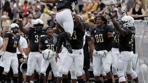 <p>               Vanderbilt running back Josh Crawford (6) celebrates after scoring a touchdown on a 1-yard run against Nevada in the second half of an NCAA college football game Saturday, Sept. 8, 2018, in Nashville, Tenn. Vanderbilt won 41-10. (AP Photo/Mark Humphrey)             </p>