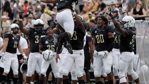 <p>               Vanderbilt running back Josh Crawford (6) celebrates after scoring a touchdown on a 1-yard run against Nevada in the second half of an NCAA college football game Saturday, Sept. 8, 2018, in Nashville, Tenn. Vanderbilt won 41-10. (AP Photo/Mark Humphrey)             </p>