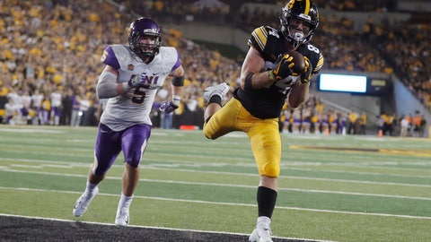 <p>               FILE - In this Sept. 15, 2018, file photo, Iowa wide receiver Nick Easley, right, catches a 14-yard touchdown pass ahead of Northern Iowa defensive back Korby Sander, left, during the second half of an NCAA college football game, in Iowa City, Iowa. The unbeaten Hawkeyes finally got their passing game going last week ahead of a key showdown with No. 18 Wisconsin. (AP Photo/Charlie Neibergall, File)             </p>