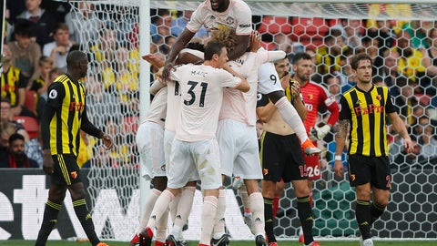 <p>               Manchester United teammates celebrate after scoring their side's second goal during the English Premier League soccer match between Watford and Manchester United at Vicarage Road stadium in Watford, England, Saturday, Sept. 15, 2018.(AP Photo/Frank Augstein)             </p>