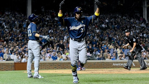 <p>               Milwaukee Brewers' Curtis Granderson (28) celebrates after he hit a home run during the ninth inning of a baseball game against the Chicago Cubs on Wednesday, Sept. 12, 2018, in Chicago. (AP Photo/Matt Marton)             </p>