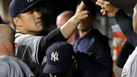 <p>               New York Yankees starting pitcher Masahiro Tanaka, left, greets teammates in the dugout after pitching the eighth inning of a baseball game against the Seattle Mariners, Friday, Sept. 7, 2018, in Seattle. The Yankees won 4-0. (AP Photo/Ted S. Warren)             </p>