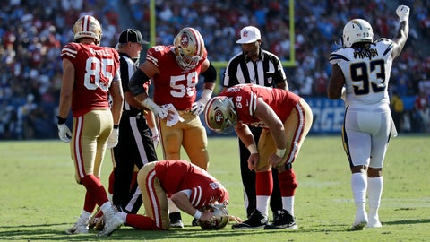 <p>               San Francisco 49ers quarterback C.J. Beathard, below, is seen to by teammates after getting tackled by Los Angeles Chargers defensive back Casey Hayward as Chargers defensive end Darius Philon, right, celebrates during the second half of an NFL football game, Sunday, Sept. 30, 2018, in Carson, Calif. (AP Photo/Marcio Sanchez)             </p>
