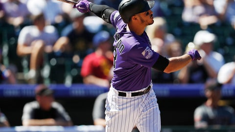 <p>               Colorado Rockies' Nolan Arenado follows the flight of his solo home run off Arizona Diamondbacks starting pitcher Matt Koch in the first inning of a baseball game Thursday, Sept. 13, 2018, in Denver. (AP Photo/David Zalubowski)             </p>