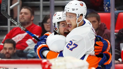 <p>               FILE - In this April 7, 2018, file photo, New York Islanders left wing Anders Lee (27) celebrates his goal against the Detroit Red Wings with Mathew Barzal in the third period of an NHL hockey game Saturday in Detroit. The Islanders have plenty of scoring options, led by Lee and reigning rookie of the year Barzal, and added a Stanley Cup winning coach in Barry Trotz and three-time champion executive Lou Lamoriello as president of hockey operations. (AP Photo/Paul Sancya, File)             </p>