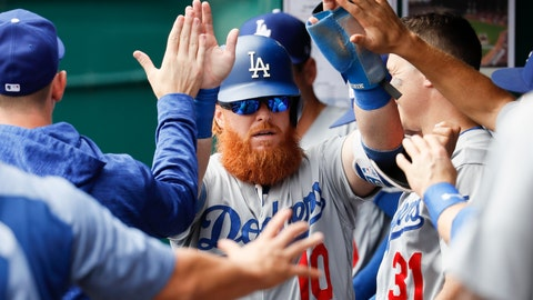 <p>               Los Angeles Dodgers' Justin Turner (10) celebrates in the dugout after scoring on an RBI single by Yasmani Grandal off Cincinnati Reds relief pitcher Wandy Peralta in the fifth inning of a baseball game, Wednesday, Sept. 12, 2018, in Cincinnati. (AP Photo/John Minchillo)             </p>