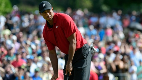 <p>               Tiger Woods motions for his putt for birdie to slow down as it passes the ninth hole during the final round of the Tour Championship golf tournament Sunday, Sept. 23, 2018, in Atlanta. (AP Photo/John Amis)             </p>