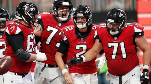 <p>               Atlanta Falcons quarterback Matt Ryan (2) celebrates his touchdown with team mates during the second half of an NFL football game against the Carolina Panthers, Sunday, Sept. 16, 2018, in Atlanta. (AP Photo/John Bazemore)             </p>
