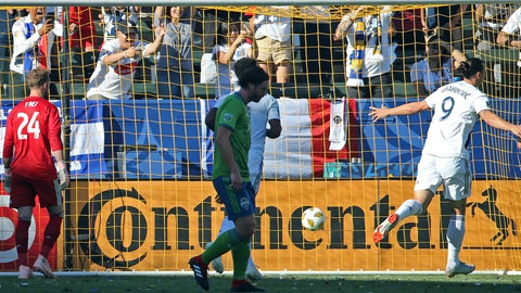 <p>               LA Galaxy forward Zlatan Ibrahimovic (9) scores a goal on Seattle Sounders goalkeeper Stefan Frei (24) in the first half of an MLS soccer match in Carson, Calif., Sunday, Sept. 23, 2018. (AP Photo/Reed Saxon)             </p>
