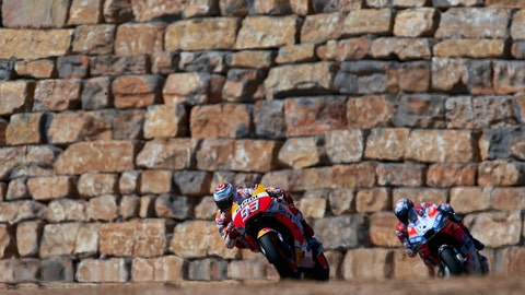 <p>               Spain's rider Marc Marquez of the Repsol Honda Team, front, steers his motorcycle followed by Italian rider Andrea Dovizioso of the Ducati Team at the MotoGP race during the Aragon Motorcycle Grand Prix at the Aragon Motorland racetrack in Alcaniz, Spain, Sunday, Sept. 23, 2018. (AP Photo/Jose Breton)             </p>