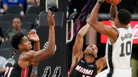 <p>               San Antonio Spurs' DeMar DeRozan (10) shoots against Miami Heat's Hassan Whiteside (21) and Rodney McGruder during the first half of an NBA preseason basketball game, Sunday, Sept. 30, 2018, in San Antonio. (AP Photo/Darren Abate)             </p>