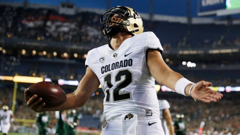 <p>               Colorado quarterback Steven Montez celebrates after his touchdown run against Colorado State in the first half of an NCAA college football game Friday, Aug. 31, 2018, in Denver. (AP Photo/David Zalubowski)             </p>
