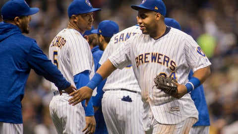 <p>               Milwaukee Brewers first baseman Jesus Aguilar, right, celebrates the Brewers victory over the Detroit Tigers during a baseball game Sunday, Sept. 30, 2018, in Milwaukee. Brewers defeated the Tigers 11-0. (AP Photo/Darren Hauck)             </p>