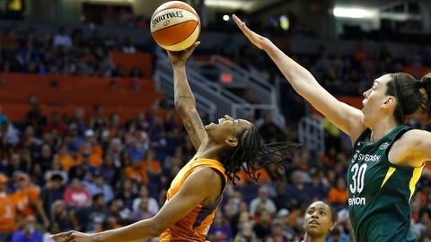 <p>               Phoenix Mercury guard Yvonne Turner, left, gets off a shot in front of Seattle Storm forward Breanna Stewart (30) as Storm guard Jewell Loyd, rear, watches during the second half of Game 3 of a WNBA basketball playoffs semifinal Friday, Aug. 31, 2018, in Phoenix. The Mercury defeated the Storm 86-66. (AP Photo/Ross D. Franklin)             </p>