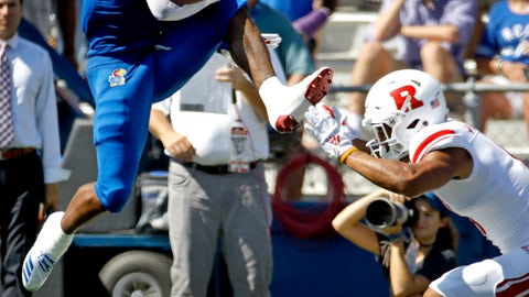 <p>               Kansas running back Pooka Williams Jr. (1) leaps over Rutgers defensive back Isaiah Wharton (11) as he runs the ball during the first half of an NCAA college football game Saturday, Sept. 15, 2018, in Lawrence. (AP Photo/Charlie Riedel)             </p>