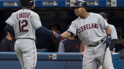 <p>               Cleveland Indians' Francisco Lindor celebrates with Jose Ramirez after he hit a leadoff home run against the Toronto Blue Jays during the first inning of a baseball game Thursday, Sept. 6, 2018, in Toronto. (Fred Thornhill/The Canadian Press via AP)             </p>