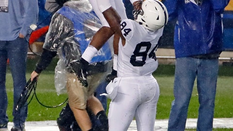 <p>               Penn State wide receiver KJ Hamler (1) is hoisted by Juwan Johnson (84) after scoring a touchdown during the first half of an NCAA college football game against Pittsburgh in Pittsburgh, Saturday, Sept. 8, 2018. (AP Photo/Gene J. Puskar)             </p>