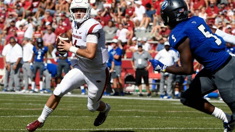 <p>               Arkansas quarterback Ty Storey tries to get past by Eastern Illinois defender Iziah Gulley in the first half of an NCAA college football game Saturday, Sept. 1, 2018, in Fayetteville, Ark. (AP Photo/Michael Woods)             </p>