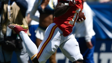 <p>               FILE - In this Sept. 9, 2018, file photo, Kansas City Chiefs wide receiver Tyreek Hill scores against the Los Angeles Chargers during the first half of an NFL football game, in Carson, Calif. Coach Andy Reid laughs and shrugs when you ask him where he draws up some of his plays. (AP Photo/Kelvin Kuo, File)             </p>