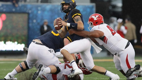 <p>               West Virginia quarterback Will Grier (7) is sacked by Youngstown State defensive tackle Wesley Thompson Wesley during the first half of an NCAA college football game Saturday, Sept. 8, 2018, in Morgantown, W.Va. (AP Photo/Raymond Thompson)             </p>
