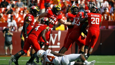 <p>               Maryland players celebrate in front of Texas wide receiver Lil'Jordan Humphrey (84) after Maryland linebacker Tre Watson, second from right, intercepted a pass intended for Humphrey in the second half of an NCAA college football game, Saturday, Sept. 1, 2018, in Landover, Md. Maryland won 34-29. (AP Photo/Patrick Semansky)             </p>