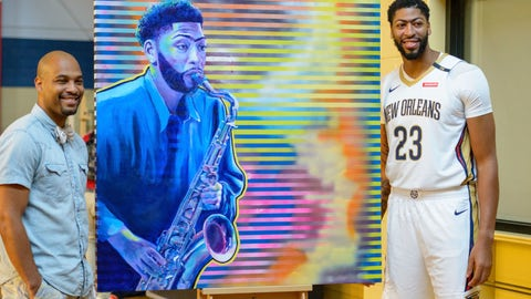 <p>               New Orleans Pelicans forward Anthony Davis (23) enjoys his portrait by artist Reuben Cheatem, left, during media day at the NBA basketball team's practice facility in Metairie, La., Monday, Sept. 24, 2018. (AP Photo/Matthew Hinton)             </p>