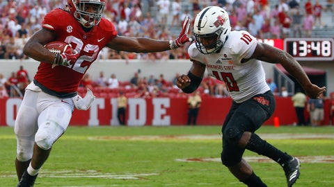 <p>               Alabama running back Najee Harris (22) stiff arms Arkansas State defensive back Justin Clifton (10) as he carries the ball during the second half of an NCAA college football game, Saturday, Sept. 8, 2018, in Tuscaloosa, Ala. Alabama won 57-7. (AP Photo/Butch Dill)             </p>